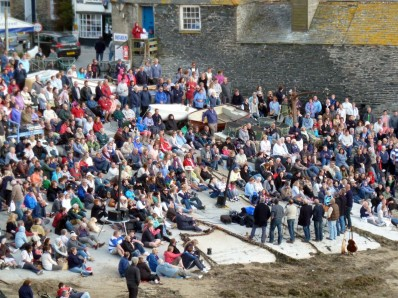 Crowds Gather Around To Watch And Listen To The Fishermans Friends In Port Isaac