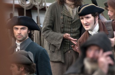 "Picture by Mike Thomas 22/010/2015. The cast of the Hit series Poldark filmed at the Historic Cornish harbour of Charlestown nr St Austell,Cornwall.""Ahoy there"" Adian Turner aka Ross Poldark shoots scene's on a 18th century tall ship."