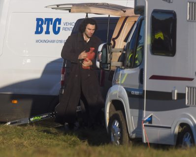 Aidan Turner, playing Ross Poldark, in the BBC's Poldark drama, clutches a hot water bottle on a bitterly cold set of Poldark near Cirencester, Glouc. 29 Nov 2016 Pic: Jon Rowley