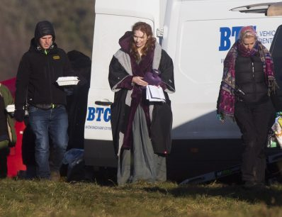 Eleanor Tomlinson, who plays Demelza Poldark, in the BBC's Poldark drama, clutches a hot water bottle on the set of Poldark near Cirencester, Glouc. 29 Nov 2016 Pic: Jon Rowley